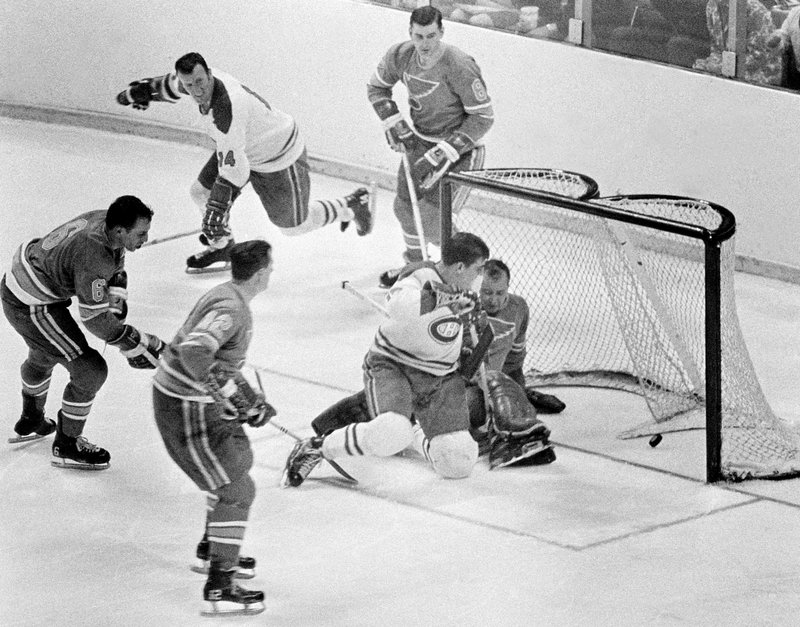FILE - Intis May 7, 1968, file photo, Montreal Canadiens' Serge Savard is about to land in the lap of St. Louis Blues' goalie Glenn Hall as the puck spins into the net for the winning goal in the NHL Stanley Cup finals at St. Louis, Mo. The Blues made the Stanley Cup Finals in their first three seasons but lost in sweeps to the Montreal Canadiens in 1968 and 1969 and the Bruins in 1970. (AP Photo/File)