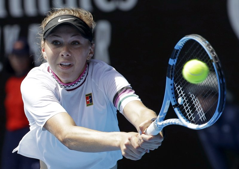 FILE - In this Jan. 20, 2019, file photo, United States' Amanda Anisimova makes a backhand return to Petra Kvitova, of the Czech Republic, during their fourth round match at the Australian Open tennis championships in Melbourne, Australia. Anisimova, 17, is a player to watch at the 2019 French Open, which begins Sunday. She is the youngest American to win a WTA title since Serena Williams in 1999. (AP Photo/Aaron Favila, File)