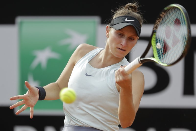 FILE - In this May 17, 2019, file photo, Marketa Vondrousova, of the Czech Republic, returns the ball to Johanna Konta of Britain during a quarterfinal match at the Italian Open tennis tournament, in Rome. Vondrousova, 19, is a player to watch at the 2019 French Open, which begins Sunday. The lefty is 21-5 since the Australian Open. (AP Photo/Andrew Medichini, File)