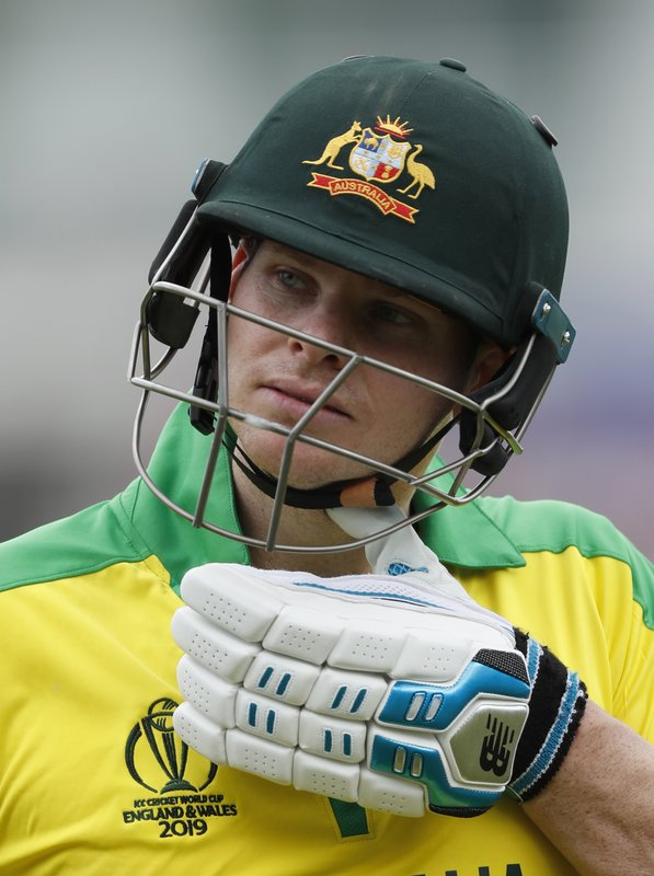 Australia's Steve Smith walks off the pitch after being given out caught and bowled by England's Tom Curran during the Cricket World Cup warm up match between England and Australia at the Rose Bowl in Southampton, England, Saturday, May 25, 2019. (AP Photo/Alastair Grant)