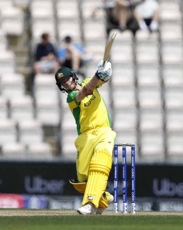 Australia's Steve Smith hits 4 runs off the bowling of England's Liam Dawson during the Cricket World Cup warm up match between England and Australia at the Rose Bowl in Southampton, England, Saturday, May 25, 2019. (AP Photo/Alastair Grant)