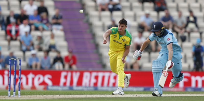CAPTION CORRECTS THE ID - Australia's Marcus Stoinis, left throws the ball to run out England's Chris Woakes, right, during the Cricket World Cup warm up match between England and Australia at the Rose Bowl in Southampton, England, Saturday, May 25, 2019. (AP Photo/Alastair Grant)