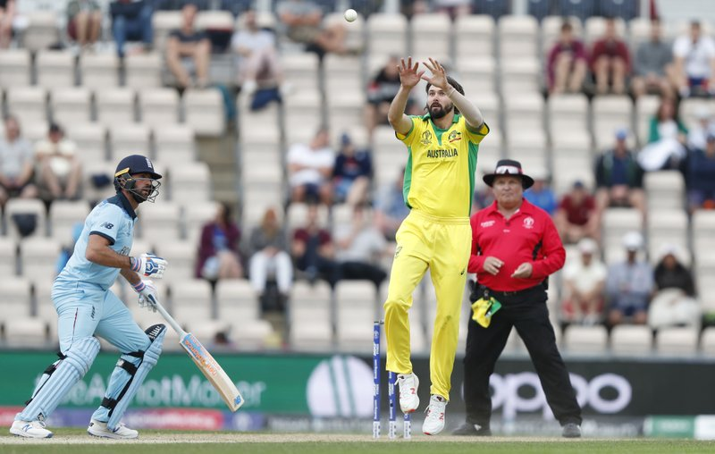 Australia's Kane Richardson leaps up to collect the ball as England's Liam Plunkett, left looks on during the Cricket World Cup warm up match between England and Australia at the Rose Bowl in Southampton, England, Saturday, May 25, 2019. (AP Photo/Alastair Grant)