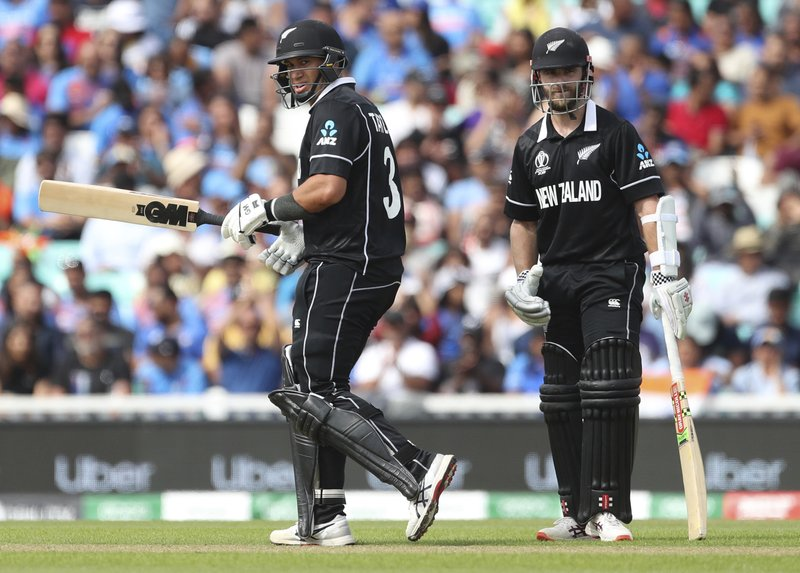 New Zealand captain Kane Williamson, right, watches as teammate Ross Taylor celebrates scoring fifty runs during the Cricket World Cup warm up match between India and New Zealand at The Oval in London, Saturday, May 25, 2019. (AP Photo/Aijaz Rahi)