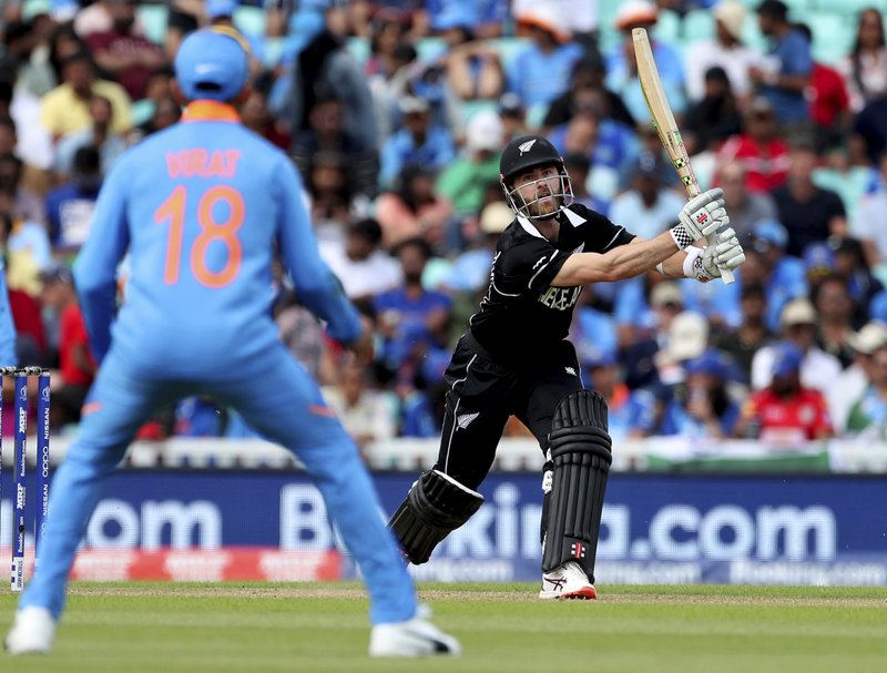 New Zealand captain Kane Williamson, right, plays a shot during the Cricket World Cup warm up match between India and New Zealand at The Oval in London, Saturday, May 25, 2019. (AP Photo/Aijaz Rahi)