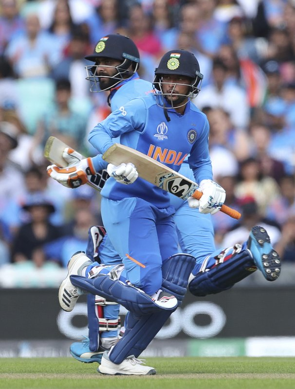 India's Ravindra Jadeja, left, and Kuldeep Yadav run between the wickets to score during the Cricket World Cup warm up match between India and New Zealand at The Oval in London, Saturday, May 25, 2019. (AP Photo/Aijaz Rahi)