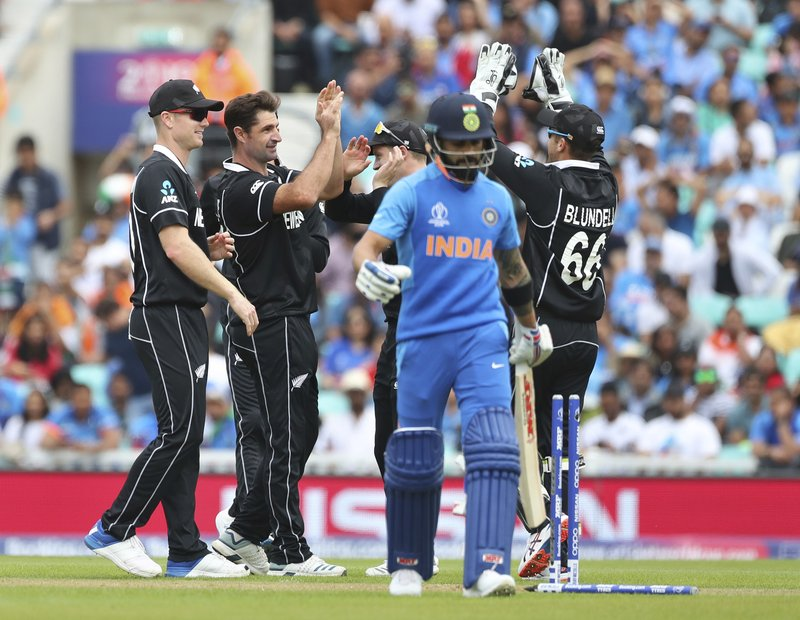 New Zealand's Colin de Grandhomme, second left, celebrates with teammates the dismissal of India's captain Virat Kohli, second right, during the Cricket World Cup warm up match between India and New Zealand at The Oval in London, Saturday, May 25, 2019. (AP Photo/Aijaz Rahi)