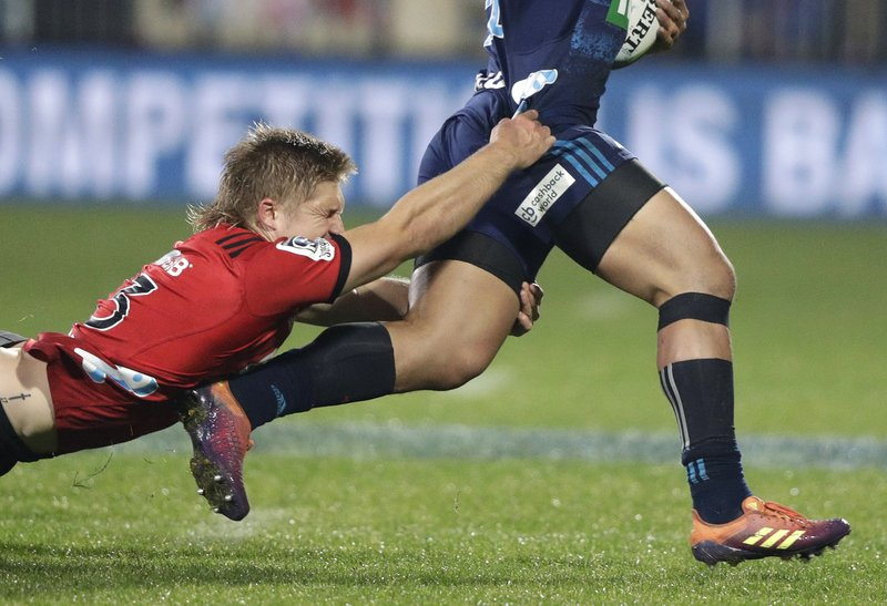 Crusaders Jack Goodhue, left, attempts to tackle Blues Caleb Clarke during their Super Rugby match in Christchurch, New Zealand, Saturday, May 25, 2019. (AP Photo/Mark Baker)
