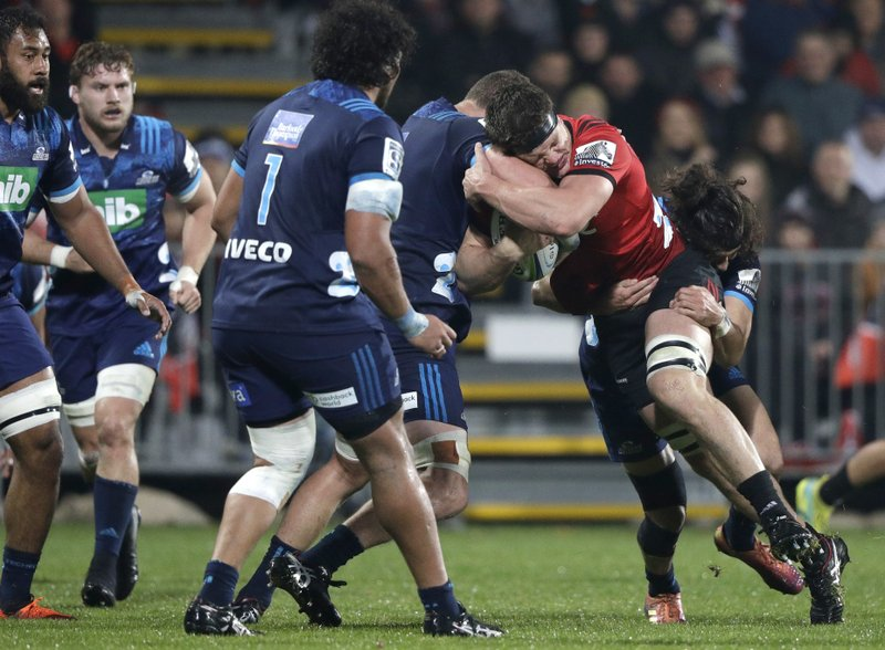 Crusaders Scott Barrett runs at the Blues defence during their Super Rugby match in Christchurch, New Zealand, Saturday, May 25, 2019. (AP Photo/Mark Baker)