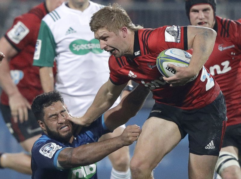 Crusaders Jack Goodhue fends off Blues Akira Ioane during their Super Rugby match in Christchurch, New Zealand, Saturday, May 25, 2019. (AP Photo/Mark Baker)