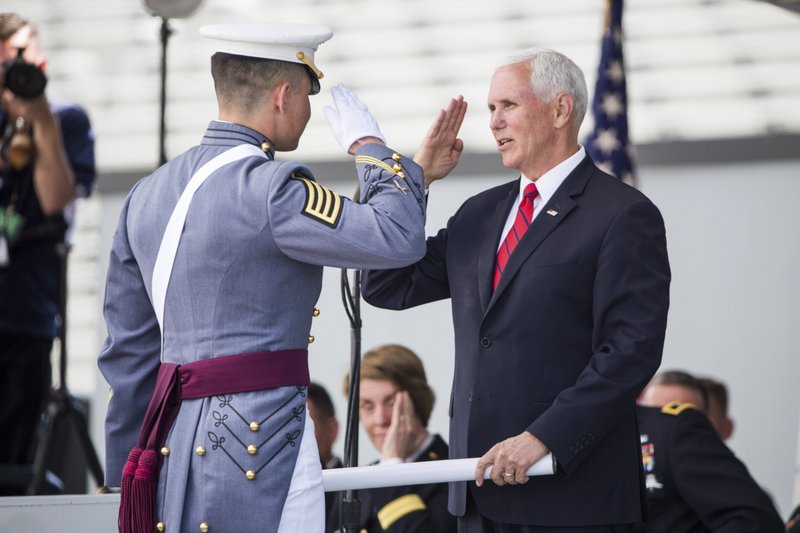 Vice President Mike Pence salutes a graduating cadet before handing him his diploma during graduation ceremonies at the United States Military Academy, Saturday, May 25, 2019, in West Point, N.Y. (AP Photo/Julius Constantine Motal)