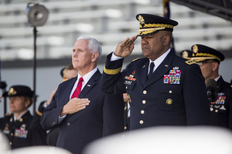Vice President Mike Pence stands for the national anthem during graduation ceremonies at the United States Military Academy, Saturday, May 25, 2019, in West Point, N.Y. (AP Photo/Julius Constantine Motal)