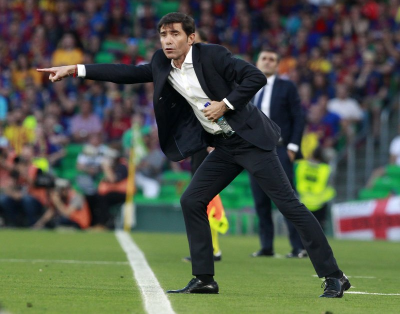 Valencia coach Marcelino Garcia gestures to his players during the Copa del Rey soccer match final between Valencia CF and FC Barcelona at the Benito Villamarin stadium in Seville, Spain, Saturday. 25, 2019. (AP Photo/Miguel Morenatti)