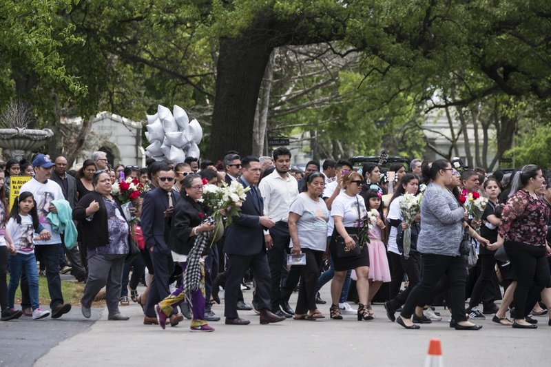 The funeral procession filled with friends and family of Marlen Ochoa-Lopez at Mount Auburn Funeral Home in Stickney, Ill., for the funeral of Marlen Ochoa-Lopez.  (Rick Majewski/Chicago Sun-Times via AP)