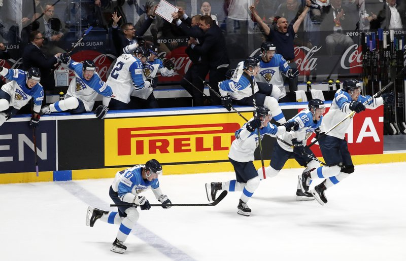 Players of Finland celebrate after winning the Ice Hockey World Championships semifinal match between Russia and Finland at the Ondrej Nepela Arena in Bratislava, Slovakia, Saturday, May 25, 2019. (AP Photo/Petr David Josek)