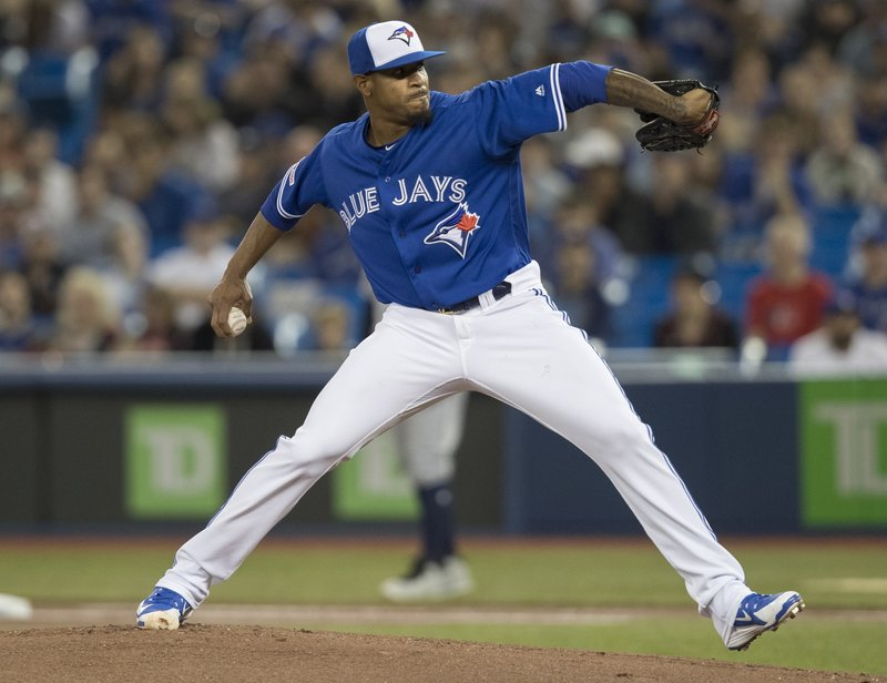 Toronto Blue Jays starting pitcher Edwin Jackson throws against the San Diego Padres during the first inning of a baseball game in Toronto on Saturday May 25, 2019. (Fred Thornhill/The Canadian Press via AP)