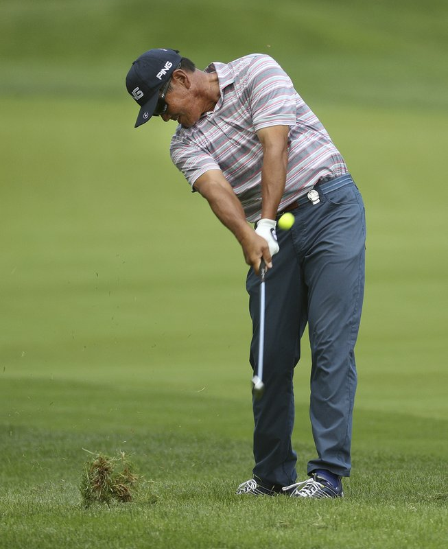 Ken Tanigawa hits from the 16th fairway during the third round of the Senior PGA Championship golf tournament, Saturday, May 25, 2019, in Pittsford, N.Y. (Jamie Germano/Democrat & Chronicle via AP)