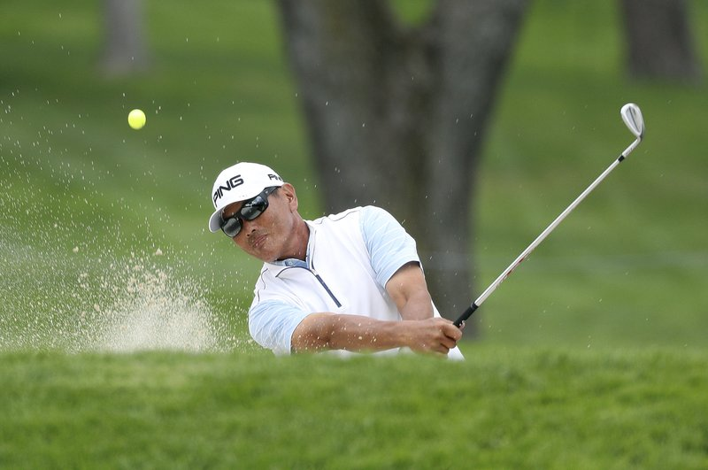 Ken Tanigawa hits out of a bunker on 17 during the second round of the Senior PGA Championship golf tournament at Oak Hill on Friday, May 24, 2019, in Pittsford, N.Y. (Jamie German/Democrat & Chronicle via AP)