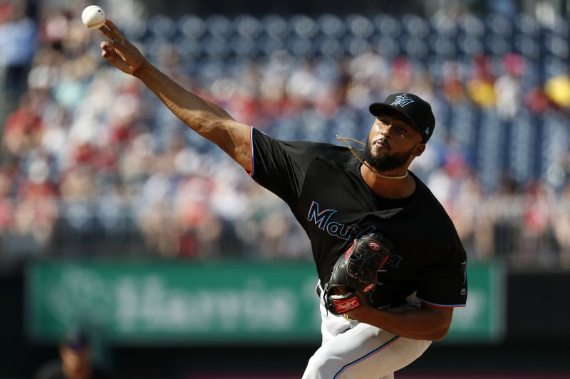 Miami Marlins starting pitcher Sandy Alcantara follows through during the second inning of a baseball game against the Washington Nationals, Saturday, May 25, 2019, in Washington. (AP Photo/Jacquelyn Martin)