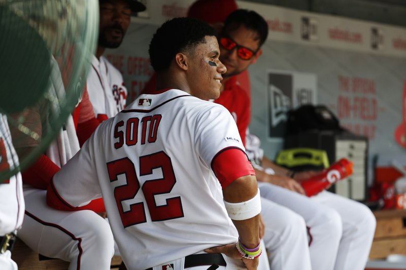 Washington Nationals left fielder Juan Soto (22) talks with teammates in the dugout during their baseball game against the Miami Marlins, Saturday, May 25, 2019, in Washington. (AP Photo/Jacquelyn Martin)