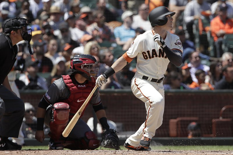 San Francisco Giants' Mike Yastrzemski, right, watches as he flies out in front of Arizona Diamondbacks catcher Alex Avila during the fourth inning of a baseball game in San Francisco, Saturday, May 25, 2019. Yastrzemski, the grandson of Hall of Famer Carl Yastrzemski, was put in the starting lineup to make his major league debut in Saturday's game against the Diamondbacks. (AP Photo/Jeff Chiu)