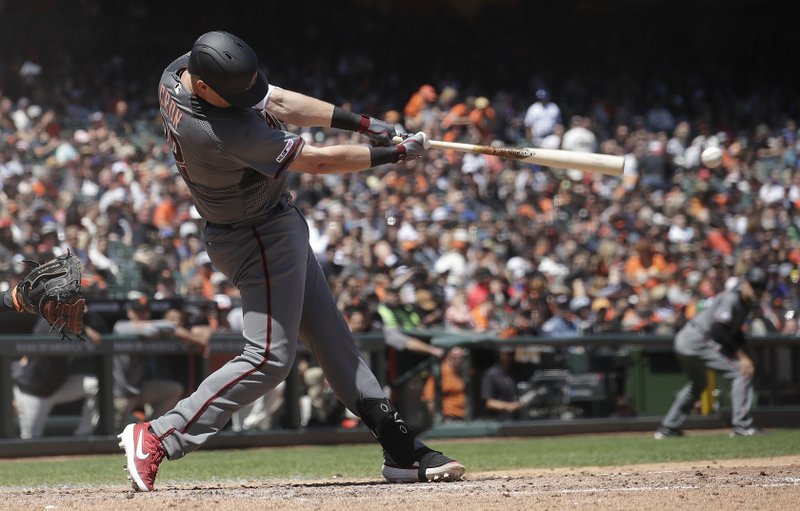 Arizona Diamondbacks' Kevin Cron hits an RBI-double against the San Francisco Giants during the fifth inning of a baseball game in San Francisco, Saturday, May 25, 2019. (AP Photo/Jeff Chiu)
