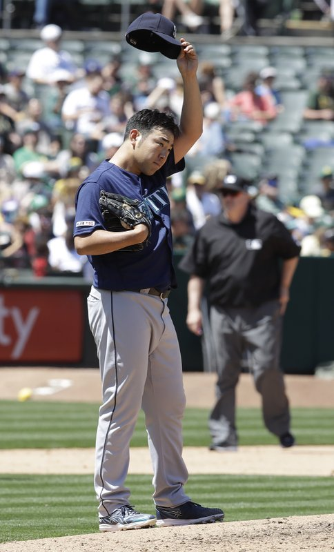 Seattle Mariners pitcher Yusei Kikuchi wipes his face in the first inning of a baseball game against the Oakland Athletics, Saturday, May 25, 2019, in Oakland, Calif. (AP Photo/Ben Margot)