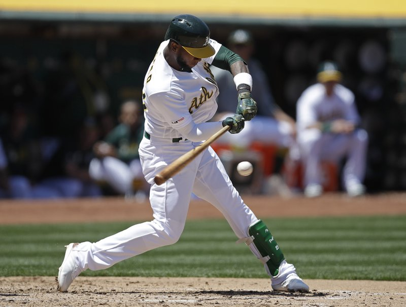 Oakland Athletics' Jurickson Profar swings for an RBI-single against the Seattle Mariners in the third inning of a baseball game Saturday, May 25, 2019, in Oakland, Calif. (AP Photo/Ben Margot)