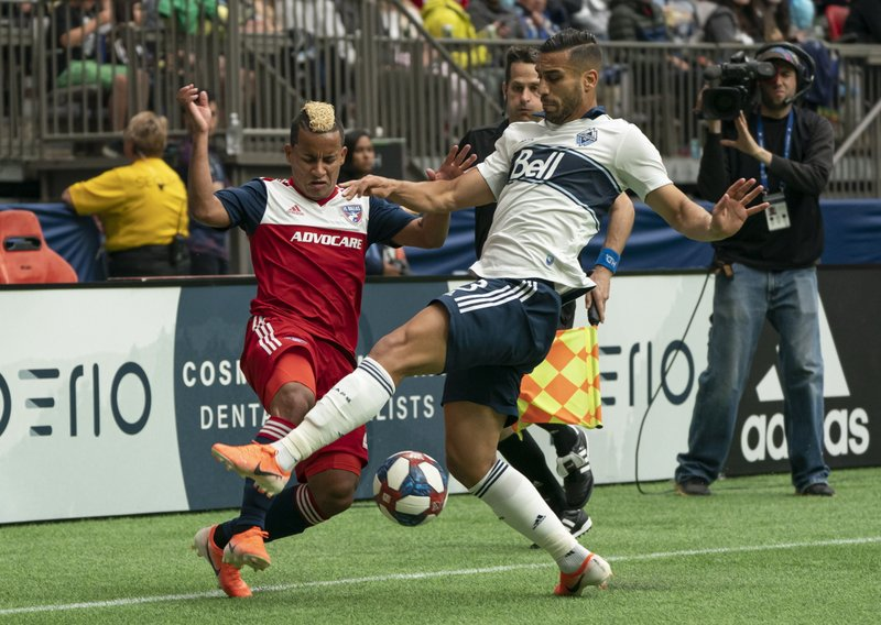 Vancouver Whitecaps' Ali Adnan, right, blocks the crossing attempt by FC Dallas' Michael Barrios during the first half of an MLS soccer match Saturday, May 25, 2019, in Vancouver, British Columbia. (Richard Lam/The Canadian Press via AP)
