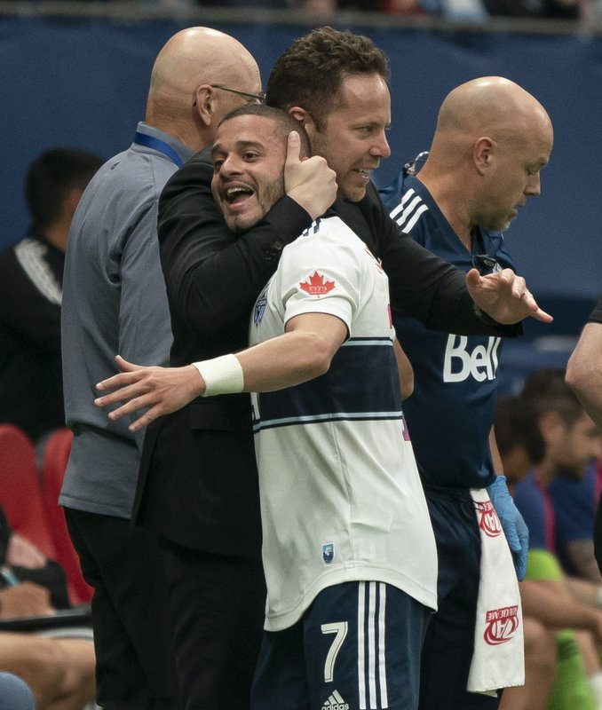 Vancouver Whitecaps' Lucas Venuto, right, celebrates with head coach Marc Dos Santos after scoring a goal against FC Dallas during the first half of an MLS soccer match Saturday, May 25, 2019, in Vancouver, British Columbia. (Richard Lam/The Canadian Press via AP)