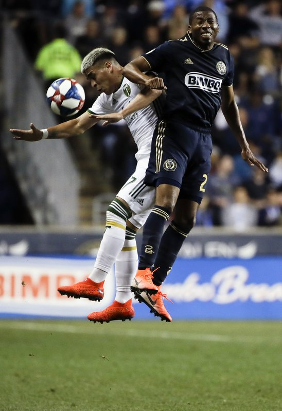 Portland Timbers' Brian Fernandez, left, and Philadelphia Union's Ray Gaddis vie for the ball during the first half of an MLS soccer match in Chester, Pa., Saturday, May 25, 2019. (AP Photo/Matt Rourke)