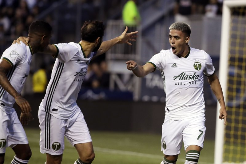 Portland Timbers' Brian Fernandez, right, reacts after scoring a goal during the first half of an MLS soccer match against the Philadelphia Union in Chester, Pa., Saturday, May 25, 2019. (AP Photo/Matt Rourke)