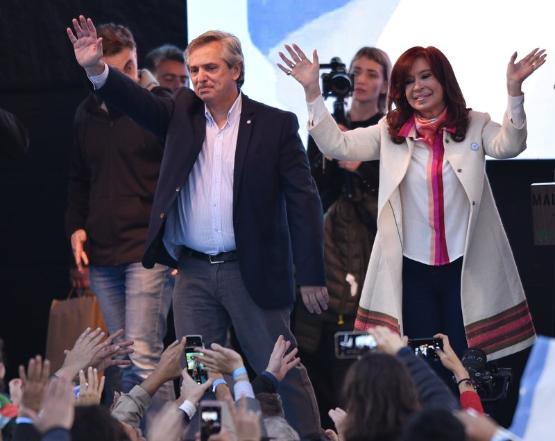 Presidential candidate Alberto Fernandez, left, and his running-mate, former President Cristina Fernandez, no relation, greet supporters during their kick-off campaign rally in Buenos Aires, Argentina, Saturday, May 25, 2019. Argentina will hold general presidential elections on Oct 27. (AP Photo/Gustavo Garello)