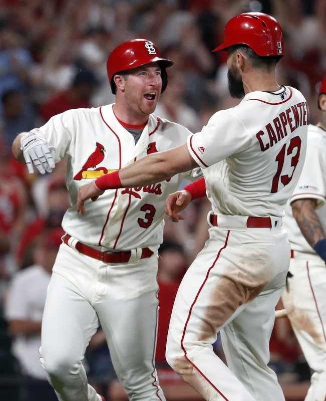 St. Louis Cardinals' Jedd Gyorko (3) is congratulated by teammate Matt Carpenter (13) after hitting a three-run home run during the eighth inning of a baseball game against the Atlanta Braves, Saturday, May 25, 2019, in St. Louis. (AP Photo/Jeff Roberson)