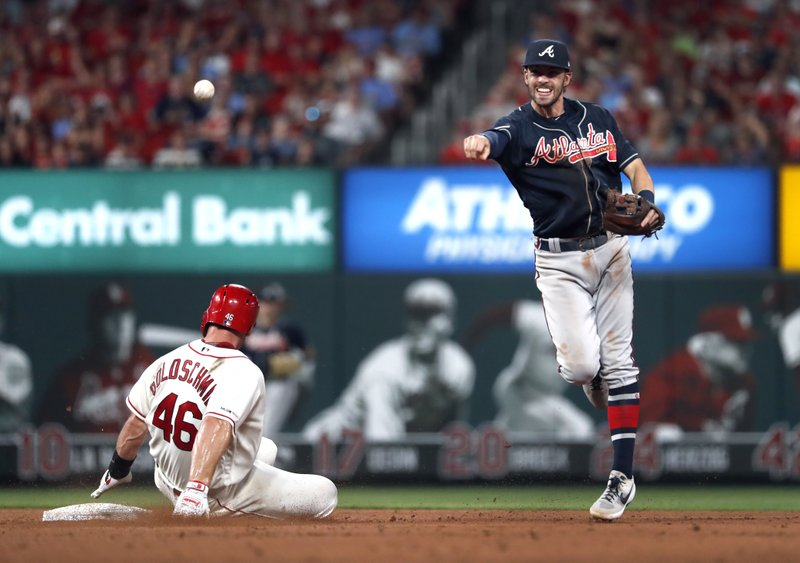 St. Louis Cardinals' Paul Goldschmidt (46) is out at second buts Atlanta Braves shortstop Dansby Swanson, right, is unable to turn a double play during the eighth inning of a baseball game Saturday, May 25, 2019, in St. Louis. Cardinals' Paul DeJong was safe at first. (AP Photo/Jeff Roberson)