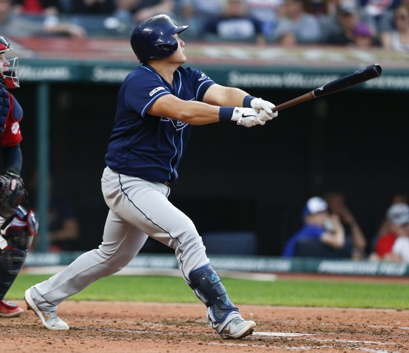 Tampa Bay Rays' Ji-Man Choi hits a two-run home run off Cleveland Indians starting pitcher Carlos Carrasco during the fifth inning of a baseball game, Saturday, May 25, 2019, in Cleveland. (AP Photo/Ron Schwane)