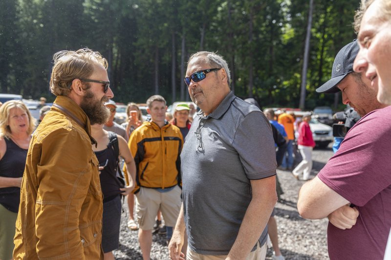 John Eller, right, father of Amanda Eller, speaks with rescue lead Chris Berquist at the Makawao Forest Reserve base camp on Saturday, May 25, 2019 in Wailuku, Maui.The Maui News reported Friday Amanda Eller was found injured in the Makawao Forest Reserve. Family spokeswoman Sarah Haynes confirmed she spoke with Eller's father John. Eller was airlifted to safety. (Bryan Berkowitz/Honolulu Star-Advertiser via AP)