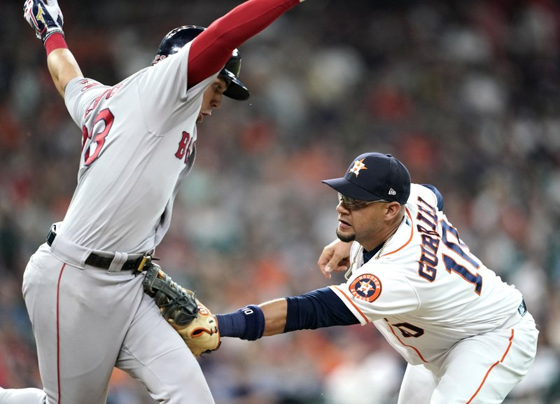 Boston Red Sox's Michael Chavis, left, is tagged out by Houston Astros first baseman Yuli Gurriel (10) during the fourth inning of a baseball game Saturday, May 25, 2019, in Houston. (AP Photo/David J. Phillip)