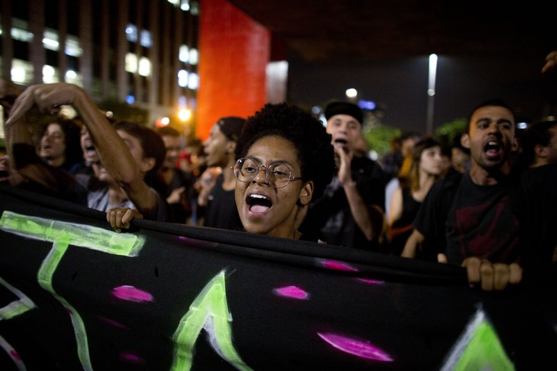 A student shouts slogans against education cuts in Sao Paulo, Brazil, Thursday, May 23, 2019. A few hundred students demonstrated in Rio de Janeiro and Sao Paulo to protest big cuts in federal funding for the public education network by President Jair Bolsonaro. (AP Photo/Victor R. Caivano)