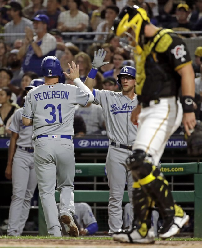 Los Angeles Dodgers' Joc Pederson (31) makes his way to the dugout after scoring on a single by Corey Seager off Pittsburgh Pirates starting pitcher Joe Musgrove during the first inning of a baseball game in Pittsburgh, Saturday, May 25, 2019. (AP Photo/Gene J. Puskar)