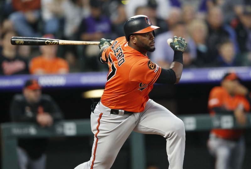 Baltimore Orioles' Hanser Alberto follows the flight of his RBI-single off Colorado Rockies starting pitcher Kyle Freeland in the fourth inning of a baseball game Saturday, May 25, 2019, in Denver. (AP Photo/David Zalubowski)