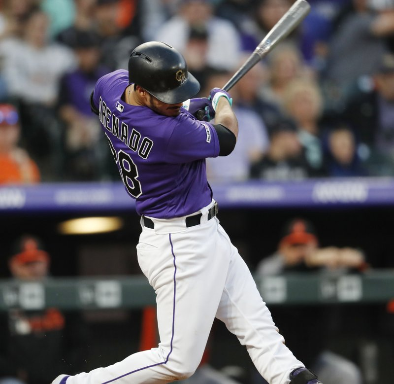 Colorado Rockies' Nolan Arenado connects for a three-run home run off Baltimore Orioles starting pitcher Andrew Cashner in the third inning of a baseball game Saturday, May 25, 2019, in Denver. (AP Photo/David Zalubowski)