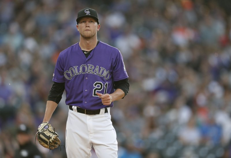 Colorado Rockies starting pitcher Kyle Freeland reacts after giving up a single to Baltimore Orioles' Keon Broxton in the first inning of a baseball game Saturday, May 25, 2019, in Denver. (AP Photo/David Zalubowski)