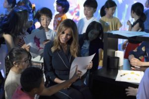 Melania Trump colors fish with kids at Japan digital museum