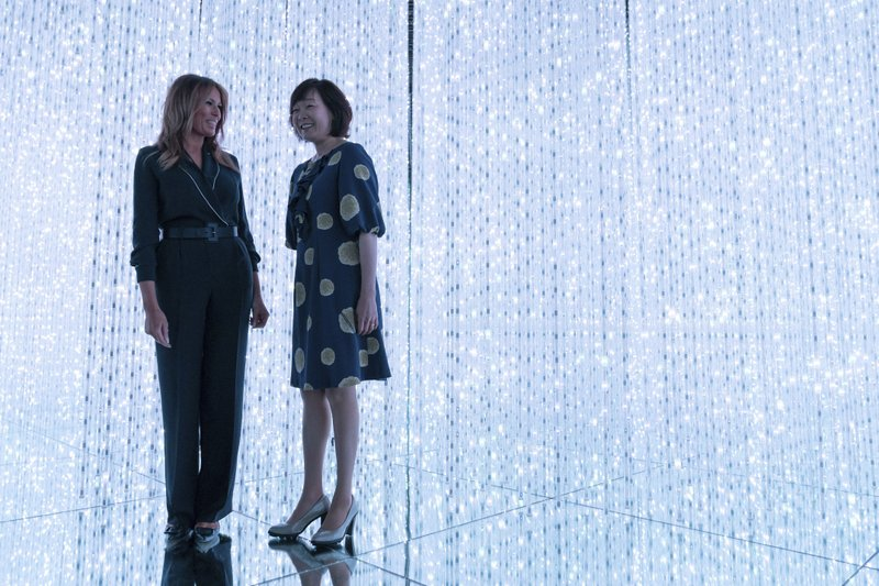 U.S. first lady Melania Trump, left, smiles with Japanese Prime Minister Shinzo Abe's wife Akie Abe during a visit to a digital art museum in Tokyo Sunday, May 26, 2019. (Pierre-Emmanuel Deletree/Pool Photo via AP)