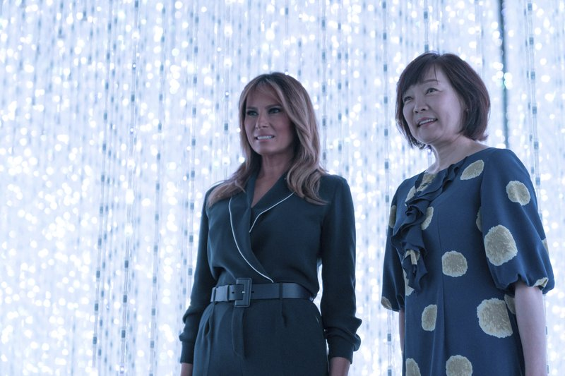 U.S. first lady Melania Trump, left, stands with Japanese Prime Minister Shinzo Abe's wife Akie Abe during a visit to a digital art museum in Tokyo Sunday, May 26, 2019. (Pierre-Emmanuel Deletree/Pool Photo via AP)