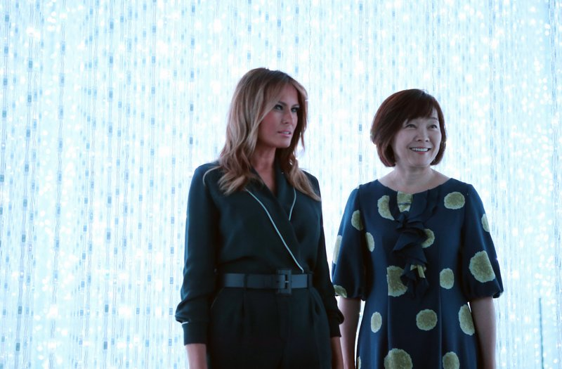 U.S. first lady Melania Trump, left, and Japanese Prime Minister Shinzo Abe's wife Akie Abe visit a digital art museum Sunday, May 26, 2019, in Tokyo. (AP Photo/Koji Sasahara)