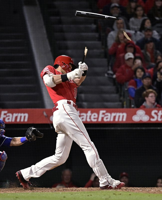 Los Angeles Angels' Shohei Ohtani, of Japan, breaks his bat as he lines out during the eighth inning of a baseball game against the Texas Rangers Saturday, May 25, 2019, in Anaheim, Calif. (AP Photo/Mark J. Terrill)