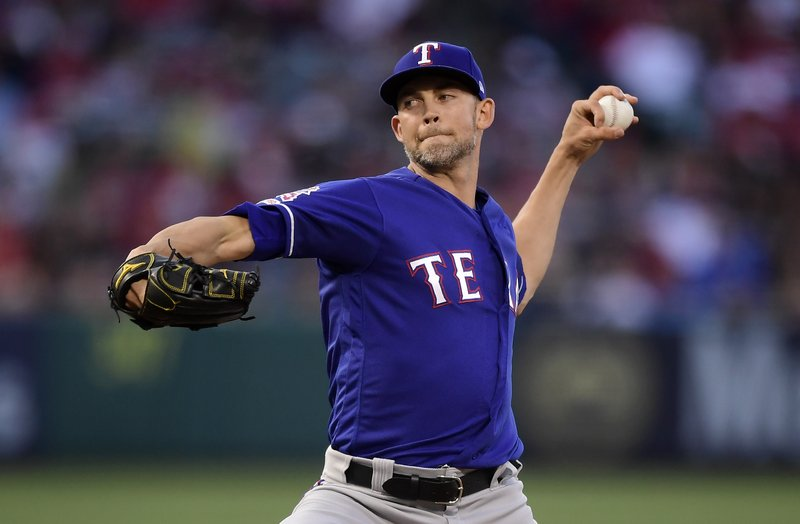 Texas Rangers starting pitcher Mike Minor throws during the first inning of the team's baseball game against the Los Angeles Angels on Saturday, May 25, 2019, in Anaheim, Calif. (AP Photo/Mark J. Terrill)