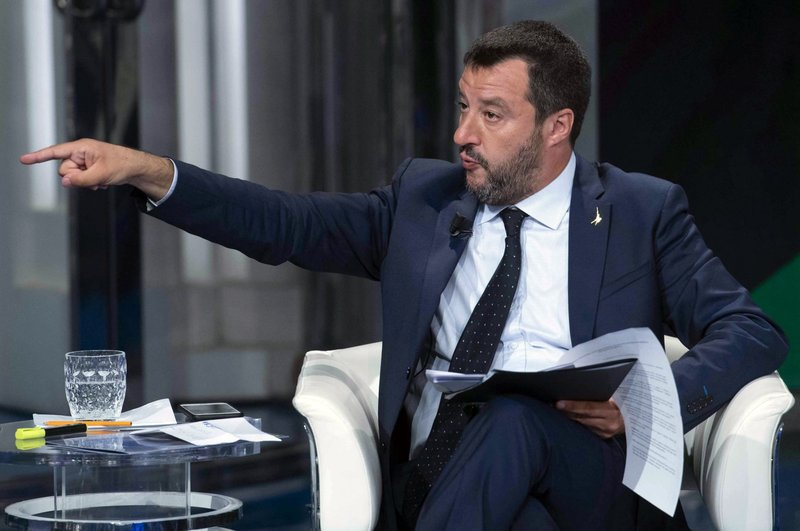 In this photo taken on Wednesday, May 22, 2019, Italian Deputy Premier and Interior Minister, Matteo Salvini, gestures as he takes part in a RAI State TV show in Rome. Dutch and British voters were the first to have their say Thursday in elections for the European Parliament, starting four days of voting across the 28-nation bloc that pits supporters of deeper integration against populist euroskeptics who want more power for their national governments. (Maurizio Brambatti/ANSA via AP)